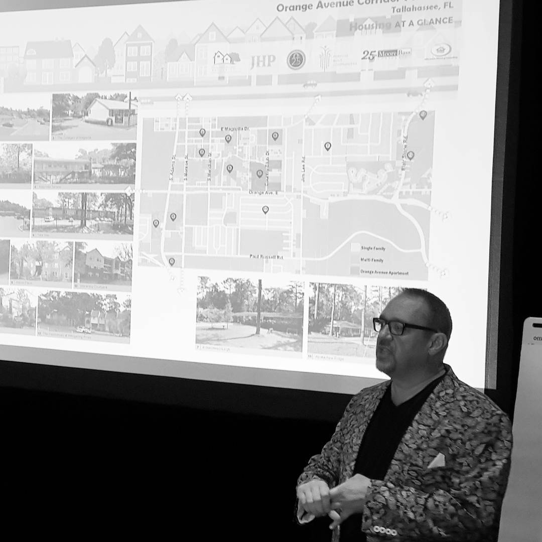 John Schrader presenting a planning & community building charette and outreach in Tallahassee.